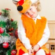 Little child girl dressed in fox suit near Christmas tree. The concept of New Year and holiday — Stock Photo #62259801