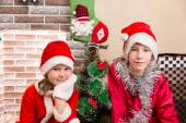 Brother and sister dressed costume Santa Claus by fireplace. Christmas and New Year — Stock Photo