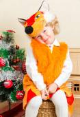Little child girl dressed in fox suit near Christmas tree. The concept of New Year and holiday — Stock Photo