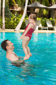 Father teaching daughter to swim — Stock Photo