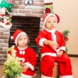 African American boy and girl dressed costume Santa Claus by fireplace. Christmas and New Year — Stock Photo #62260209
