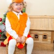 Little child girl dressed in fox suit near Christmas tree. The concept of New Year and holiday — Stock Photo #62260375