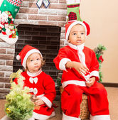 African American boy and girl dressed costume Santa Claus by fireplace. Christmas and New Year — Stock Photo