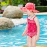 Girl near swimming pool — Stock Photo #62870905