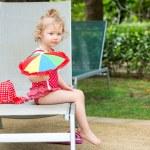 Girl near swimming pool — Stock Photo #62870913