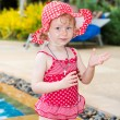 Little child girl near swimming pool — Stok fotoğraf #70387779