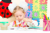 Cute child girl drawing with colorful pencils — Stock Photo