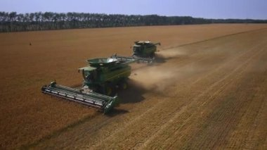 Aerial flight over harvesters — Stock Video
