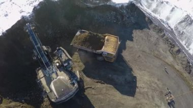 Aerial view of huge quarry trucks — Stock Video