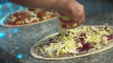 Cooking pizza and sprinkle with cheese — Stock Video