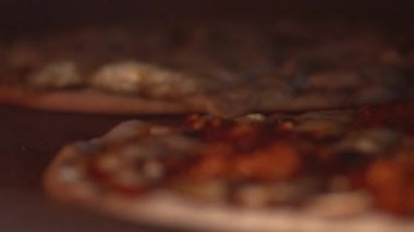 Cooking pizza in a stone oven — Stock Video