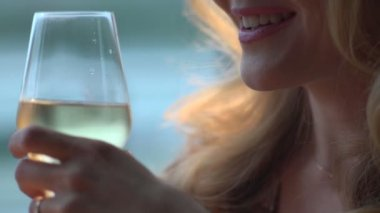 Blond woman drinking champagne — Stock Video