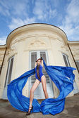 Woman dancing with blue fabric — Stock Photo