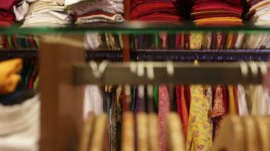 Woman chooses clothes in a shop — Stock Video