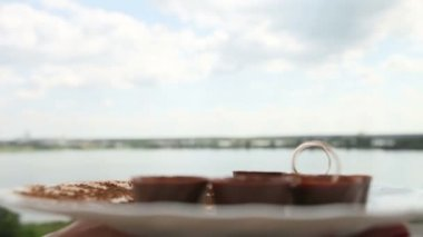 Rings on  chocolate candy — Stock Video