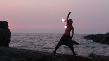 Man turns fire poi — Stock Video