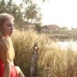 Young woman near lake — Stock Video #61618671