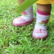 Little girl  on green grass — Stock Video #61619633