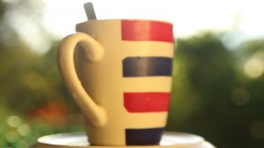 Striped cup with coffee — Stock Video