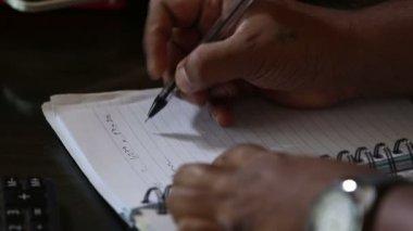 Man  writing notes — Stock Video