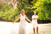 Bride and groom on beach — Stock Photo
