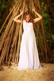 Bride at tropical plants — Stock Photo