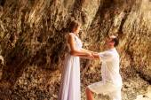 Bride and groom on beach — Stock Photo