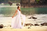 Blonde bride on beach — Stock Photo