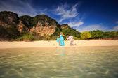 Happy asian couple on island — Stock Photo