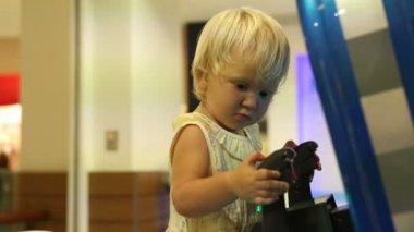 Little girl with joystick — Stock Video