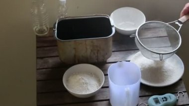 Woman sifting  flour — Stock Video