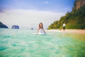 Bride and groom in tropic sea — Stock Photo
