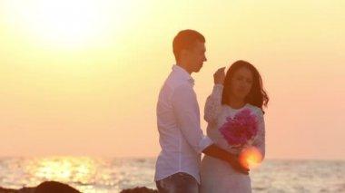 Groom and bride on sea beach — ストックビデオ