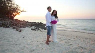 Bride and groom on sea beach — ストックビデオ