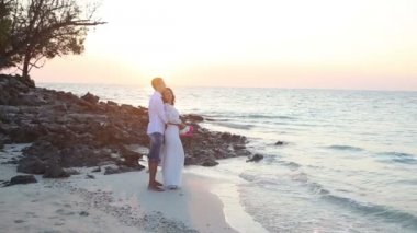 Bride and groom on sea beach — Stock video