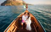 Bride and groom in longtail boat — Foto de Stock