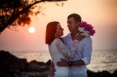 Bride and groom hugging at  beach — Stock Photo