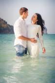 Bride and groom on sea beach — Foto de Stock