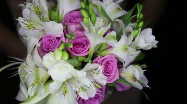 Wedding bouquet in brides hands — Stock Video