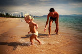 Father and daughter  on sand beach — Stock Photo