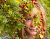 Girl amongst flowering shrubs. — Stock Photo