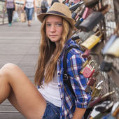 Girl on bridge with locks — Stock Photo
