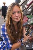 Girl on bridge with locks — Photo