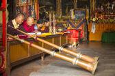 Unidentified Buddhist lama play music — Stock Photo