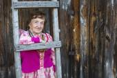 Old woman in ethnic clothes — Stock Photo