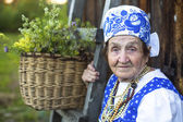 Old woman in Slav folk costume — Stock Photo