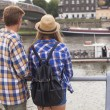 Young romantic couple on river bank — Stock Photo #53657107