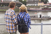 Young romantic couple on river bank — Stock Photo