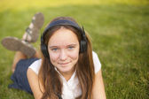 Pretty young girl in headphones — Stock Photo
