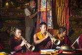 Buddhist lama play music near stupa Boudhanath — Stock Photo